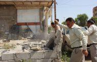 تخریب ساخت و ساز غیر قانونی در حریم پل شهید چمران منطقه اسکاچ توسط شهرداری مسجدسلیمان